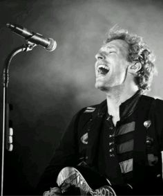 "Chris Martin ""Tell me your secrets and ask me your questions Oh, let's go back to the start"""