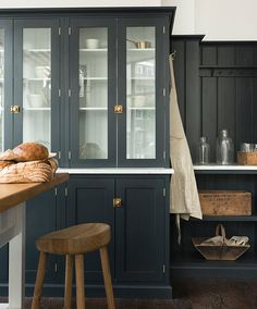 deVOL Kitchens [UK], Charcoal cupboards with marble worktops.