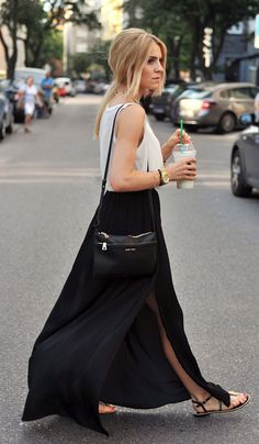 Katarzyna Tusk is wearing a black skirt from Zara, shoes from River Island, top from Oysho and the purse is from Mango