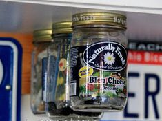 Use dangling jars to store and organize small items. | 44 Cheap And Easy Ways To Organize Your RV/Camper