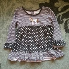 Girls 4T Dress like Long sleeve shirt Adorable long sleeve frilly pink and brown shirt with stripes & polka dots. Has cute horse with boots design on front and buttons on back. It looks like when the shirt was made, that the tag maybe went through, but we've  only used this shirt once. In good condition, gently used. No tears or stains Toffee Apple Other