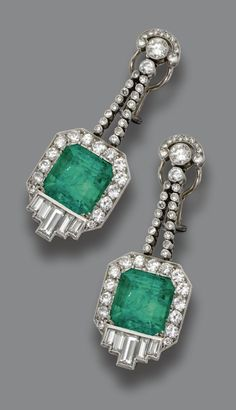 PAIR OF EMERALD AND DIAMOND PENDANT-EARCLIPS, CIRCA 1935.  Designed and fringes of round diamonds, anchored by 2 square emerald-cut emeralds weighing approximately 12.00 carats, surrounded by round and baguette diamonds, total diamond weight approximately 5.20 carats, mounted in platinum.