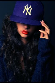 Hair , lipstick and hat ... Well I guess the whole look Is fab!
