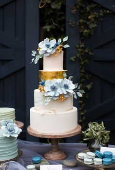 Cloudberry Bakery cake with blue sugar flowers and gold leaf