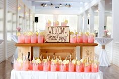 As guests arrive, have a display of cocktails to welcome them (perhaps a coral or orange colored drink)