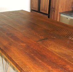 This is a nice sampling of some of the reclaimed wood countertops that we've done in the past. You can see that much of our work has lots of color color variation and character. Our tops are not perfectly flat, but are functionally smooth with a great aged look. For more