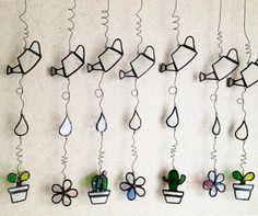 Stained glass watering can flower ornament