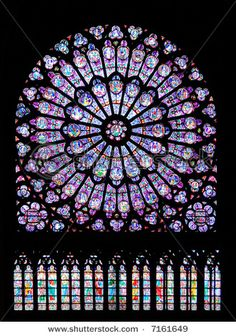 Stained glass window in Notre dame cathedral, Paris, France  photo from Shutter Stock