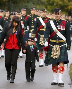 Leading the line: Marus Cirillo, 5, (centre) attends the funeral procession for his father, Cpl. Nathan Cirillo in Hamilton. Corporal Nathan Cirillo, 24, was one of two soldiers killed in a pair of attacks carried out by apparent Islamic radicals last week