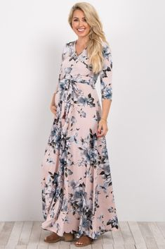 A floral printed maternity maxi dress. V-neckline. Perfect for nursing after pregnancy. Sash tie. 3/4 sleeves. This style was created to be worn before, during, and after pregnancy.