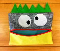 monster pencil case   free pattern here:  http://www.unitednotions.com/fp_lil-monster-pencil-case.pdf
