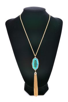 Falling in love with this iridescent blue tassel necklace!!