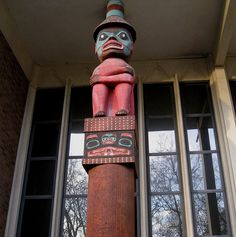 Replica of Tlingit Mortuary Pole (cat. no. R-299). A chest at the top of the original mortuary pole held the remains of a Tlingit chief. On this replica pole, the figure of a high-ranking man wears a prestigious ringed basketry hat and sits on a carved bentwood chest. The original pole stood in the village of Old Wrangell (Kasitlan), near present-day Wrangell, Alaska. The noted artist Kadyisdu.áxch probably carved that mortuary pole. This replica was carved by Bill Holm