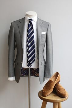 Professional and balanced... grey slacks would be a nice addition.