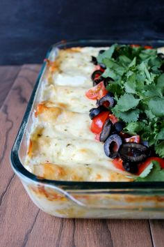 These Lonestar Chicken Enchiladas are SO GOOD. They are creamy, and cheesy and so good piled with fresh tomatoes and cilantro!