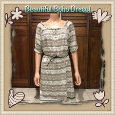 NWT Boho Dress Pretty boho dress with tan and white print, wide scoop neck can be worn off shoulder, 3/4 length cuffed sleeves, elastic collar and waist, dark brown rope style belt included! Perfect NWT condition! ✅ASK QUESTIONS ✅Bundle ✅Offers ❌NO Trades ❌NO Off-site Transactions Route 66 Dresses