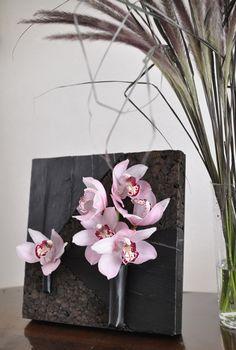 cymbidium, black leaf, pennisetum, cork board