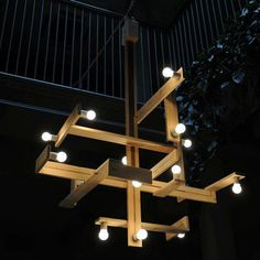 Wood Pallets Chandelier - The pallet was cut, different sizes of pieces were selected, and they were put together and secured n a very artistic way. The result was a very unique and functional chandelier. Cool DIY Chandelier Ideas for Inspiration, http://hative.com/cool-diy-chandelier-ideas-for-inspiration/,