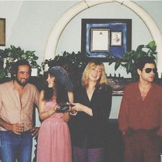 John, Stevie   ~ ☆♥❤♥☆ ~    Christine and Lindz, at an awards presentation for Fleetwood Mac's 1979 'Tusk' album; behind them is a pair of presumably fake elephant tusks forming an arch