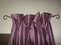 to get a poufy curtain without the ruffle look, place ring clips on the back at 4-5 inches from the top