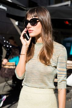 Blogger and certified street style star Patricia Manfield debuted a new hairstyle in Milan during the week: one featuring blunt, short bangs. Does this foretell of a return to the style, perhaps with a retro-infused mood? Quite possibly. The style surely looks on-point when worn with a pair of cat-eye sunglasses and vintage-inspired sweater.