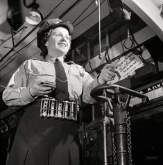 June 1943. Washington, DC  Hattie B. Sheehan, a streetcar conductor for the Capital Transit Company. And if all you have is bills, no problem. Photo by Esther Bubley for the Office of War Information.