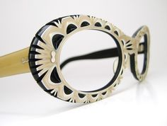Vintage 60s Funky Cat Eye Eyeglasses Frame...OMG>>>too bad these are vintage cause i LOVE them...they remind me of eyelet lace