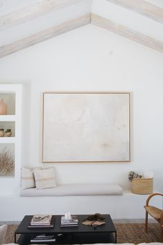 Large subtle abstract art with pastel colors + bench seat in the living room + built-in drywall niches | Kate Zimmerman-Turpin