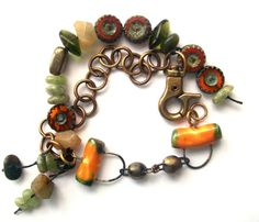 This is a great fun colorful bracelet. The center focal are two Scorched Earth connectors. Wonderful earthy colors of orange and green glass beads. Natural stones of Green Kyanite, Indian Agates, Quartz and Pyrite. Pure Brass 10mm link chain finishes it off, with a large brass lobster claw clasp! I think you'll love it!! -- Bohemian Earthy Bracelet Natural Stone Scorched by SheFliesAgain