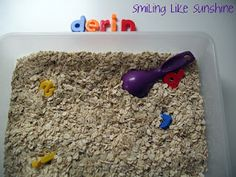 Smiling like Sunshine: Name Recognition Game in a Sensory Tray - I have yet to color a bag of rice so I used oatmeal and our magnetic letters. D. (28 months old)  likes scooping and handling the oatmeal and finding his letters.  It is important to expose children to lower case letters as most of the reading is done with these. Capital letters are only used at the beginning of a name or a sentence in English.