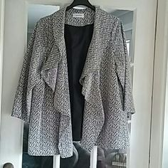 Calvin Klein draped jacket / swing coat NEW Calvin Klein draped jacket /swing coat new with tags. Black and white chevron design drapes nicely size 24 women never worn. the fit on this jacket makes it easy to size up or down. Calvin Klein Jackets & Coats
