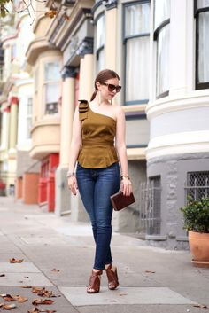 Olive Bows | Ginger Side of Life  Every red head loves wearing olive green! Paired a one shoulder top with jeans for an evening outfit.