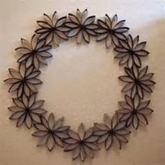 Toilet Paper Roll Art - I must try thisRisultati immagini per toilet paper roll snowflakeWreaths are always great ways to decorate your home for any season, but buying them can be expensive. Check out this Thrifty Paper Flowers Wreath for an elegant Toilet Paper Roll Art, Toilet Paper Roll Crafts, Cardboard Crafts, Diy Paper, Cardboard Tubes, Paper Towel Roll Crafts, Paper Towel Rolls, Paper Flowers, Diy Crafts
