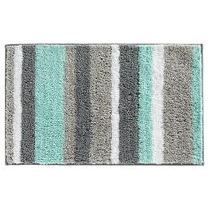 Crafted of plush microfiber polyester, this casual stripe pattern brings style to any bath or home setting. Treat yourself to a rug that is comfortable, absorbent, and sized to fit compact spaces.
