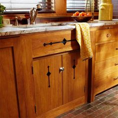 Cutouts in this kitchen sink cabinet were inspired by period-style decorative patterns