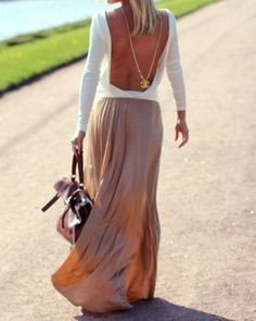 that maxi skirt, open back knit, Chanel chain and charm.