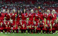 Canada's women's soccer team poses for a team photo after being presented with their bronze medal at the 2012 Summer Olympics in Coventry, England, Thursday August Olympic Football, Olympic Medals, Olympic Games, Soccer Team Photos, Soccer Post, Canada Soccer, Football Tournament, Football Team, 2012 Summer Olympics