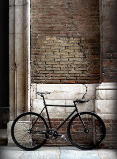 Sleek, timeless black bicycle.