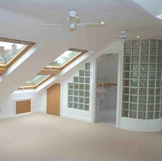 Attic room with privacy glass dividers
