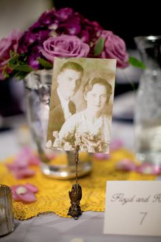 #family-photos, #centerpiece    Event Design: Bliss Events - blissevents.net  Photography: Yan Photo - yanphoto.com  Floral Design: Edwards Greenhouse - edwardsgreenhouse.com    Read More: http://www.stylemepretty.com/2012/06/27/fashion-beauty-e-magazine-real-wedding-peek-by-yan-photography/