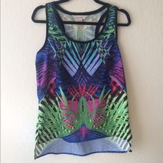 Sleeveless top Top is in great conditions and perfect for the summer the colors are beautiful and bright. It is tighter on top and lose at bottom. Decree Tops Blouses