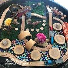 Our tuff tray as a dinosaur and train world filled with loose parts and beautiful sensory items. Great for preschoolers to build imagination and language skills. Eyfs Activities, Nursery Activities, Dinosaur Activities, Train Activities, Preschool Activities, Dinosaur Small World, Small World Play, Tuff Spot, Baby Sensory