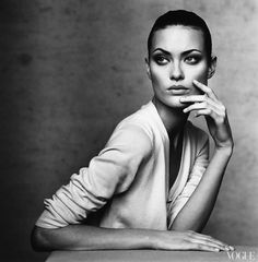 Shalom Harlow by Irving Penn for Vogue,1996. The model appears to be lost in thought and quite relaxed, however the power balance is still introduced slightly as the facial expression is quite stern.