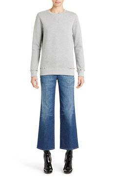 Free shipping and returns on Valentino Studded Crewneck Sweatshirt at Nordstrom.com. Shining goldtone pyramid studs trace the cuffs and hem of a luxe crewneck sweatshirt crafted in Italy from soft heathered terry and framed in rib-knit trim.