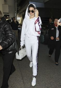 Kendall Jenner Photos Photos - Reality star turned model Kendall Jenner rocks all white while arriving on a flight at LAX in Los Angeles, California on January 25, 2017. - Kendall Jenner Touches Down at LAX