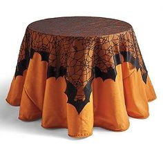 Spiderwebs may give off the appearance of a lace-like pattern, but the bats can't be mistaken, making up the edges of this table topper.