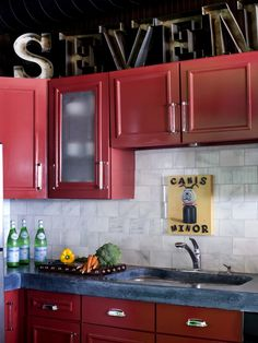 Red cabinets make for a colorful, contemporary kitchen.