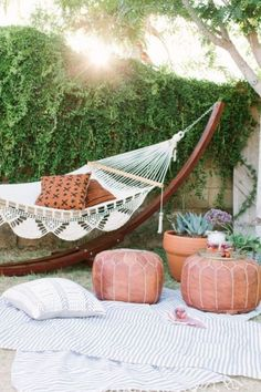 WITH HAYNEEDLE This crocheted hammock looks so dreamy. Love the vintage pillows and the outdoor leather poufs from HayneedleThis crocheted hammock looks so dreamy. Love the vintage pillows and the outdoor leather poufs from Hayneedle Large Backyard Landscaping, Backyard Hammock, Patio Hammock Ideas, Pergola Ideas, Outdoor Hammock, Backyard Ideas, Backyard Patio, Garden Ideas, Patio Ideas