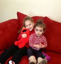 Our newest Workers' Comp Case Manager, Raquel Dacosta, asked her nieces to put on some red for the cause. They put on red, sat on a red couch, and threw in a red Elmo too.
