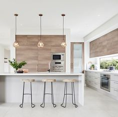 Love the clean lines, and those lights... #kitchen #scandi